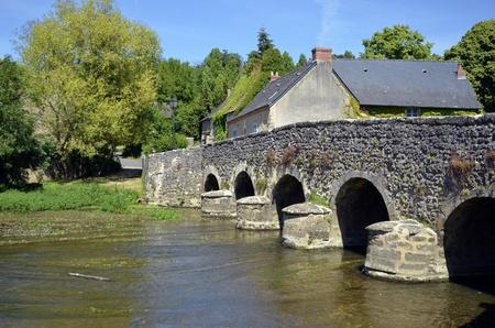 res: Old bridge on V&amp,egrave,gre river at Asni&amp,egrave,res sur V&amp,egrave,gre in France, commune of the Pays de la Loire region in north-western France