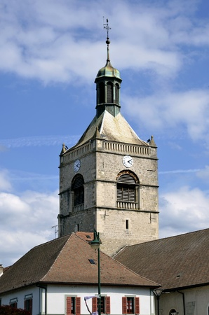 alpes: Bell tower of church l Assomption of Evian-les-Bains on the banks of L&eacute,man lake to the east of France, commune in the Haute-Savoie department  Stock Photo