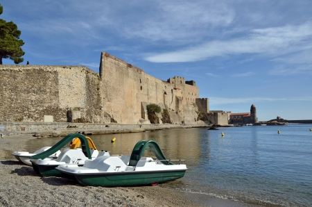middle ages boat: The castle walls and pedalos at Collioure, commune on the c�te vermeille in the Pyr�n�es-Orientales department, Languedoc-Roussillon region, in southern France.
