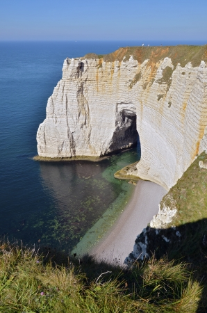 Famous downstream cliffs of Etretat and the natural arche La Manneporte. Etretat is a commune in the Seine-Maritime department in the Haute-Normandie region in northwestern France photo