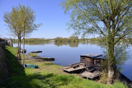 candes: The banks of the Vienne river at Candes-Saint-Martin with trees and small boats, commune in the Indre-et-Loire department , Centre region in France