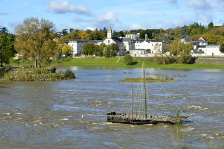 et: River Loire with wreck and chapel of the Grande Bretèche in the background at at Tours, city in central France, the capital of the Indre et Loire department, Centre region