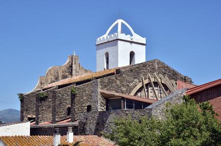 alt: Santa Maria de les Neus church at El Port de la Selva, municipality in the comarca of the Alt Emporda in Catalonia in Girona province  Stock Photo
