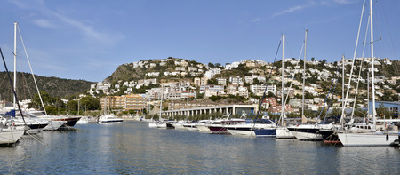 Panoramic photo of port and town of Roses, or Rosas, commune on the Costa Brava at northeastern Catalonia in Spain Stock Photo