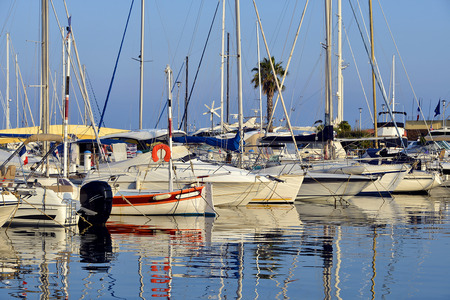 alpes: Port of Le Lavandou with big reflections on water, is a commune in the Var department in the Provence-Alpes-Cote Azur region in southeastern France Stock Photo