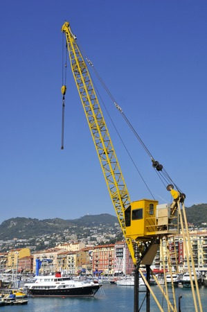 alpes maritimes: Closeup of yellow crane in the port of Nice in southeastern France, department Alpes maritimes