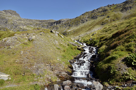 Stream in the French Alps near of Col du Petit-Saint-Bernard  Little St Bernard Pass , Rhone-Alpes region in France photo