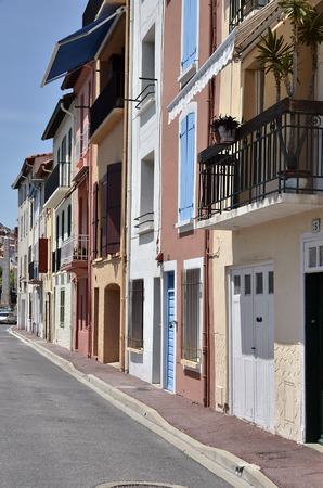 port vendres: Street and facades of buildings of Port-Vendres, commune on the cote vermeille in the Pyrenees-Orientales department, Languedoc-Roussillon region, in southern France  Stock Photo