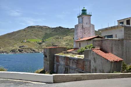 port vendres: Lighthouse and buildings at Port-Vendres, commune on the cote vermeille in the Pyrenees-Orientales department, Languedoc-Roussillon region, in southern France  Stock Photo
