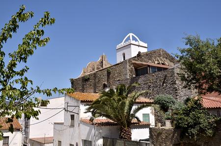 alt: Town and Santa Maria de les Neus church at El Port de la Selva Port de la Selva or municipality in the comarca of the Alt Empord in Catalonia in Girona province.