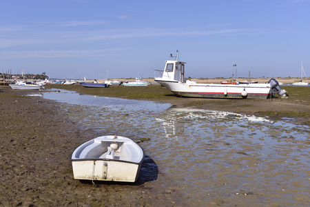 gironde: Boats at low tide at CapFerret common ostreicole Located on shore of Arcachon Bay in the Gironde department in southwestern France.