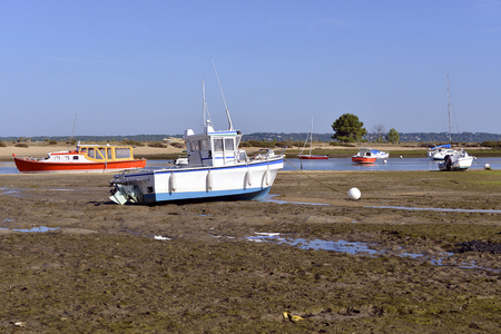 gironde: Boats at low tide at Cap Ferret, common ostreicole Located on shore of Arcachon Bay, in the Gironde department in southwestern France. Stock Photo