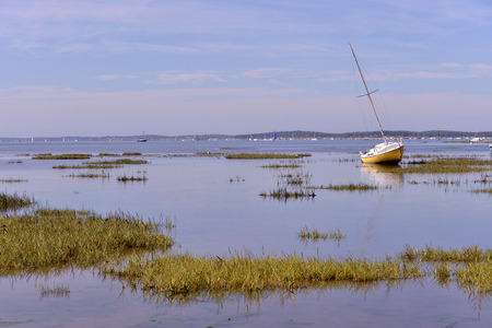 gironde: Sailboat at low tide at Ars, common ostreicole Located on shore of Arcachon Bay, in the Gironde department in southwestern France.