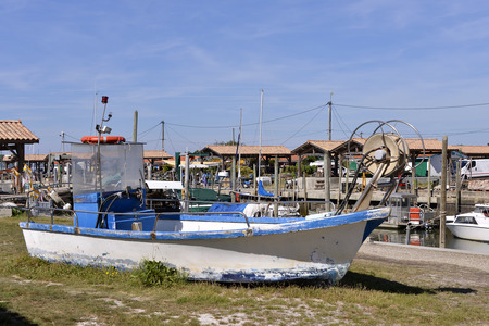 gironde: Fishing boat at harbor of oyster Andernos-les-Bains, is a town Located on the Northeast shore of Arcachon Bay, in the Gironde department in southwestern France. Stock Photo