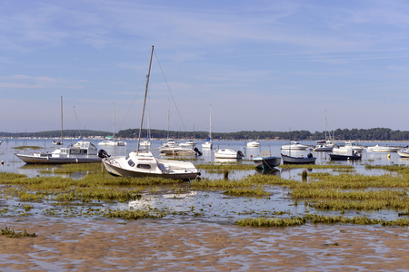 aras: Boats at low tide at Ars, common ostreicole Located on shore of Arcachon Bay, in the Gironde department in southwestern France. Stock Photo