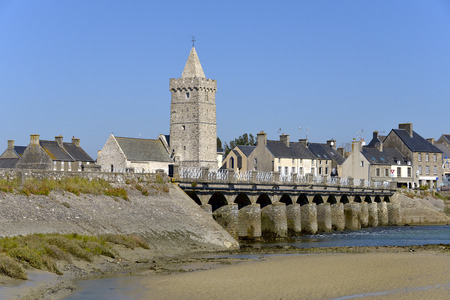 manche: Church of Notre-Dame and old bridge at Port-Bail or Porbail, a commune in the peninsula of Cotentin in the Manche department in Lower Normandy in north-western France