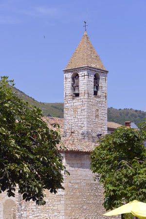 alpes maritimes: Bell tower of Saint Gregory church at Tourrettes-sur-Loup in southeastern France, Region Provence, Alpes Maritimes department Stock Photo