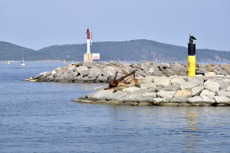 beacons: Metallic beacons at the entrance of the port of Cannes, in the Var department common in the Provence-Alpes-Cte dAzur Region in southeastern France.