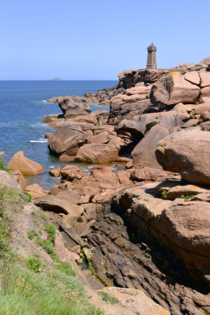 commune: Mean Ruz lighthouse on the famous Pink Granite Coast cte de granite rose in french at Ploumanach, village in the commune of Perros-Guirec. It is found in the region Bretagne in the Ctes-dArmor department in the west of France.