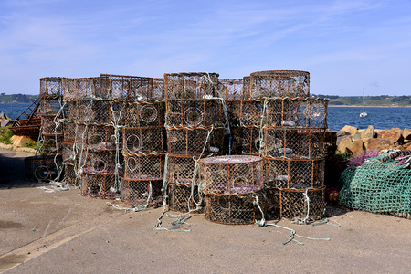 lobster pots: Stack of lobster pot at Trdrez-Locqumeau in french Brittany Stock Photo