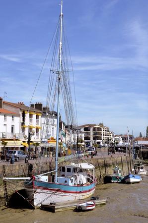 pays: Boats in the port of Pornic at low tide in Pays de la Loire region in western France