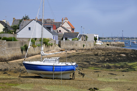 littoral: Boat at low tide in the port of Port-Louis, the Morbihan department in Brittany in north-western France Stock Photo