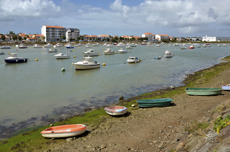 vend: Port of Saint-Gilles-Croix-de-Vie with small boats on the bank, common in the Vend  e department in the Pays de la Loire Region in western France
