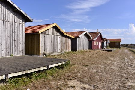 gironde department: Ostreicole wooden cabins at Larros town is a Located on the shore of Arcachon Bay, in the Gironde department in southwestern France. Stock Photo