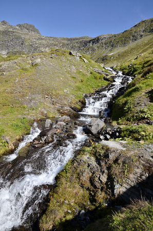 st bernard: Stream in the French Alps near of Little St Bernard Pass (Little St. Bernard Pass), Rhone-Alpes Region in France Stock Photo