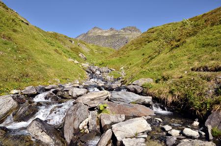 st bernard: Stream in the French Alps near of Little St Bernard Pass (Little St. Bernard Pass), Rhone-Alpes Region in France Stock Photo