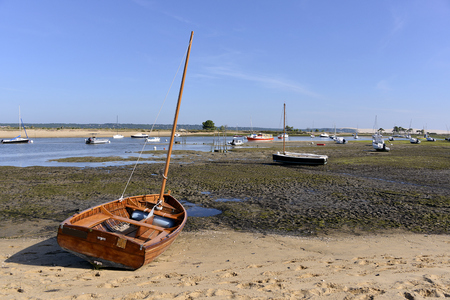 Boats at low tide at Cap Ferret, common ostreicole Located on shore of Arcachon Bay, in the Gironde department in southwestern France. Stock Photo