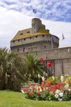 english channel: Keep behind the ramparts at Saint-Malo and flowers in the foreground. Saint-Malo is a walled harbor city in Brittany in northwestern France on the English Channel. It is a sub-prefecture of the Ille-et-Vilaine department.