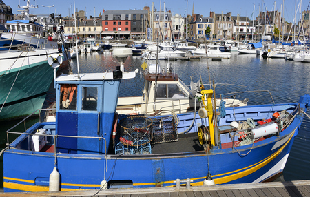 Fish boat in the harbor of Paimpol, a commune in the Côtes dArmor department in Brittany in northwestern France Stock Photo
