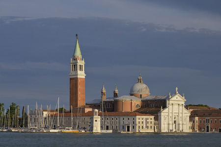 Basilica of San Giorgio Maggiore and the harbor in Venice, a famous city in northeastern Italy and the capital of the Veneto Region. The lagoon and a share of the city are listed as a World Heritage Site Stock Photo