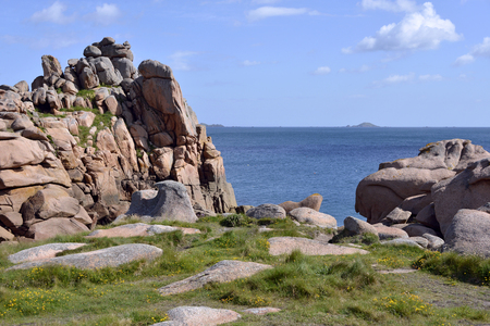ploumanach: Famous Pink Granite Coast (pink granite coast in french) of Ploumanach with islands For monks and Bono in the background. Ploumanach is a town in the municipality of Perros-Guirec. It is found in the area Brittany in the Cotes dArmor department in the we Stock Photo