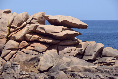 ploumanach: Famous pink granite rocks on the coast of Ploumanach (pink granite coast in french), village in the commune of Perros-Guirec. It is found in the region Brittany in the Cotes dArmor department in the west of France.