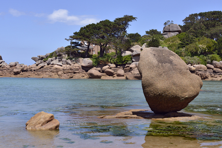 Famous pink granite rocks on the coast at Ploumanach, village in the commune of Perros-Guirec. It is found in the region Brittany in the Cotes dArmor department in the west of France. Stock Photo
