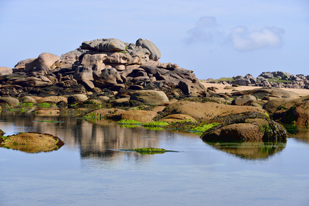 Famous Pink Granite Coast of Peninsula Renote at tragastel, common in the Coast darmor department of the region of Brittany in northwestern France Stock Photo
