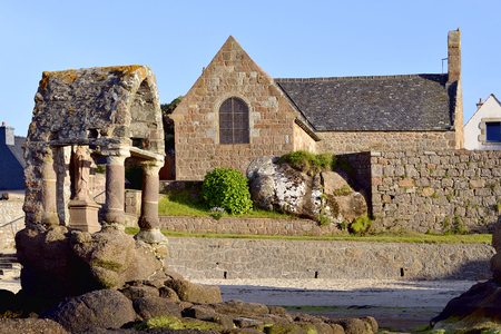 ploumanach: The famous old Oratory Saint-Guirec building and Saint-Guirec church at low tide on the Pink Granite Coast of Ploumanach, village in the commune of Perros-Guirec. It is in the region of Brittany in the Cotes-dArmor department in the west of France.