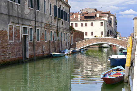 Canal and bridge in Venice, a famous city in northeastern Italy and the capital of the Veneto Region.