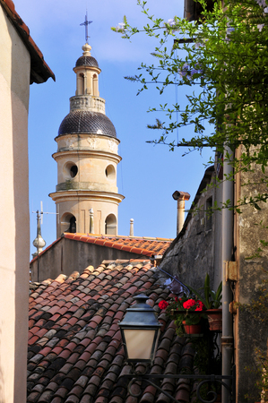 maritimes: Tower bell of Baroque Basilica of Saint Michael Archangel at Menton, a commune in the Alpes-Maritimes department in the Provence-Alpes-Cote dAzur region in southeastern France.