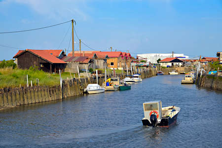 Boats at high tide in the ostreicole harbor of Larros of the commune Gujan-Mestra located on the shore of Arcachon Bay, in the Gironde department in southwestern France