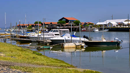 Panoramic photo of boats at high tide in the ostreicole harbor of Larros of the commune Gujan-Mestra located on the shore of Arcachon Bay, in the Gironde department in southwestern France