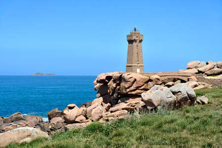 Mean Ruz lighthouse on the famous Pink Granite Coast (côte de granite rose in french) at Ploumanac'h, village in the commune of Perros-Guirec