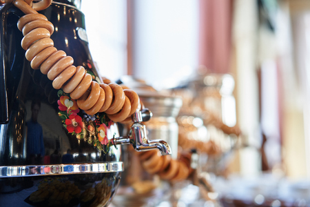 Russian traditional painted samovar with delicious herbal tea and delicious donuts