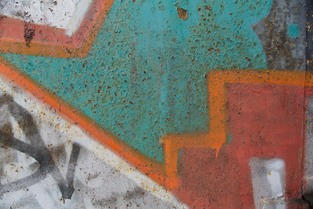 Texture of old wall with colorful graffiti