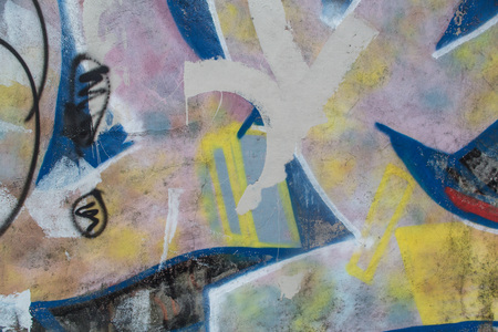 Texture of old beautiful wall with colorful graffiti fragment
