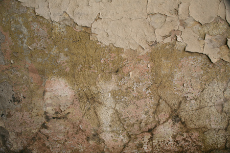 Texture of old cracked plaster painted wall