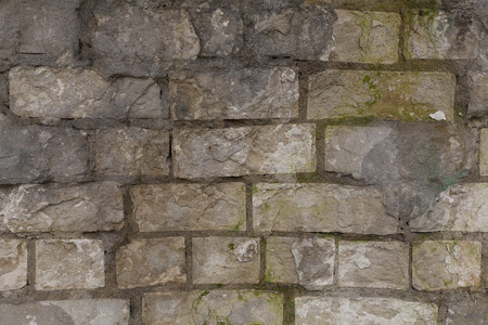 Old crumbling rough brick wall texture Stock Photo
