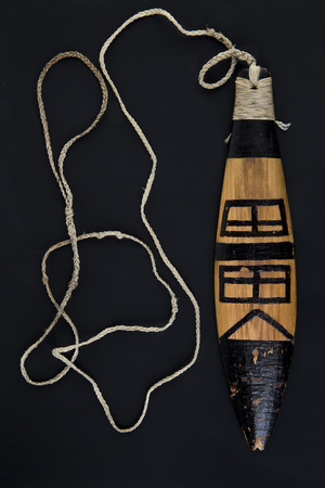 Replica of ancient artifact rainmaker bullroarer Stock Photo